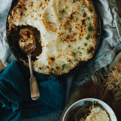 over head shot of Moroccan Sheppards Pie with a heaping portion removed from skillet