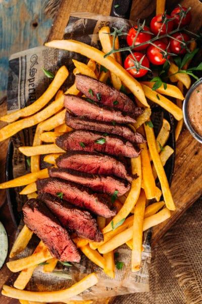 Sous Vide Flat Iron Steak sliced over frites