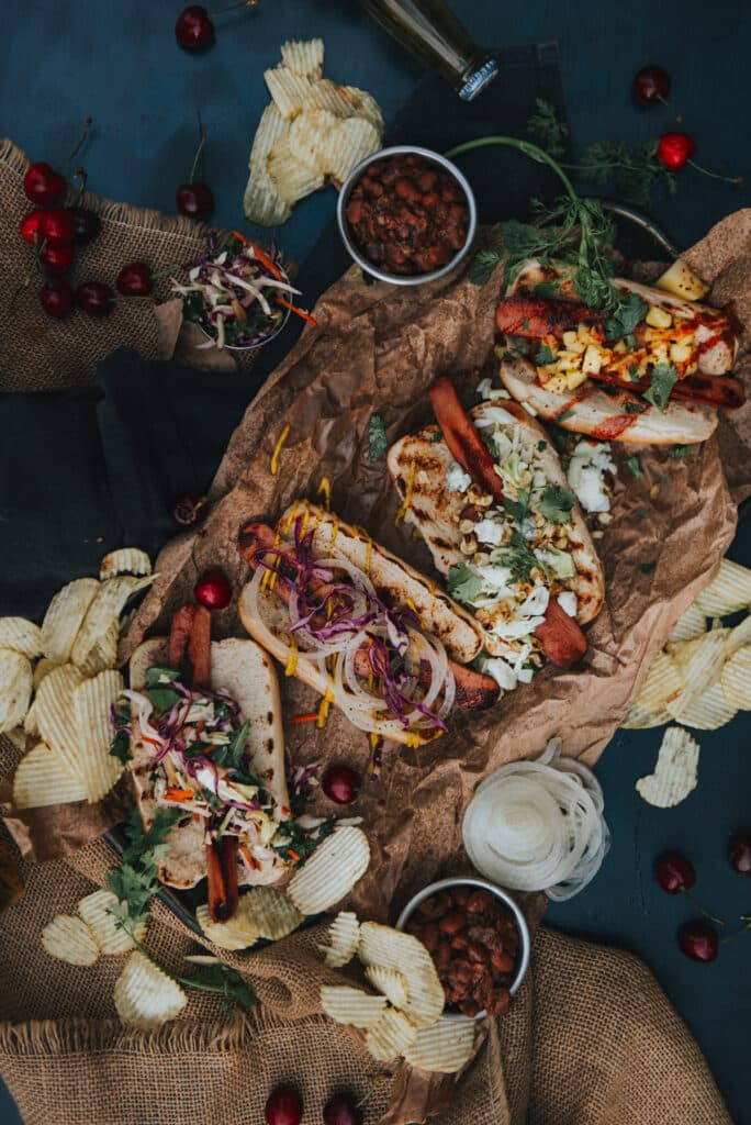 Platter of hot dogs from above with variety of toppings