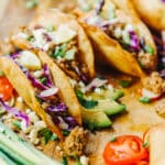 crispy fried tacos filled with ground pork and fresh veggies