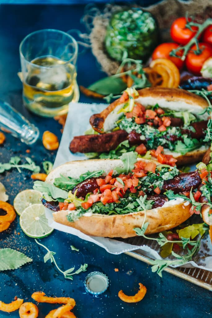 Choripán, The Argentinian Grilled Sausage Sandwiches with grilled chorizo sausages and chimichurri