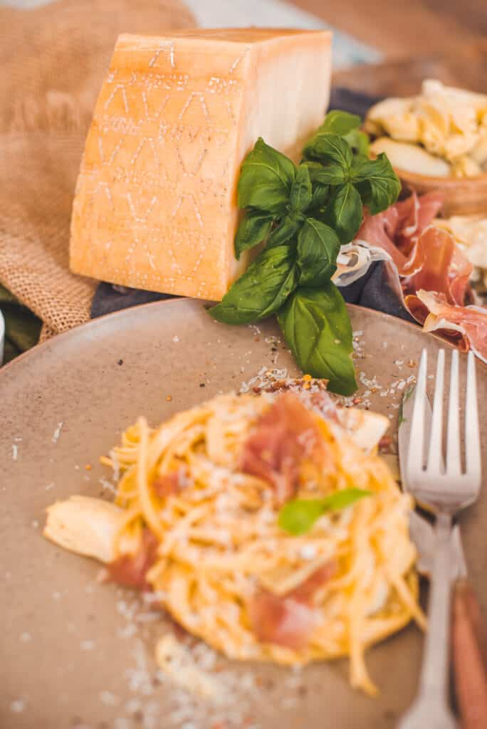 Serviced Carbonara and Grana Padano Cheese in a Table