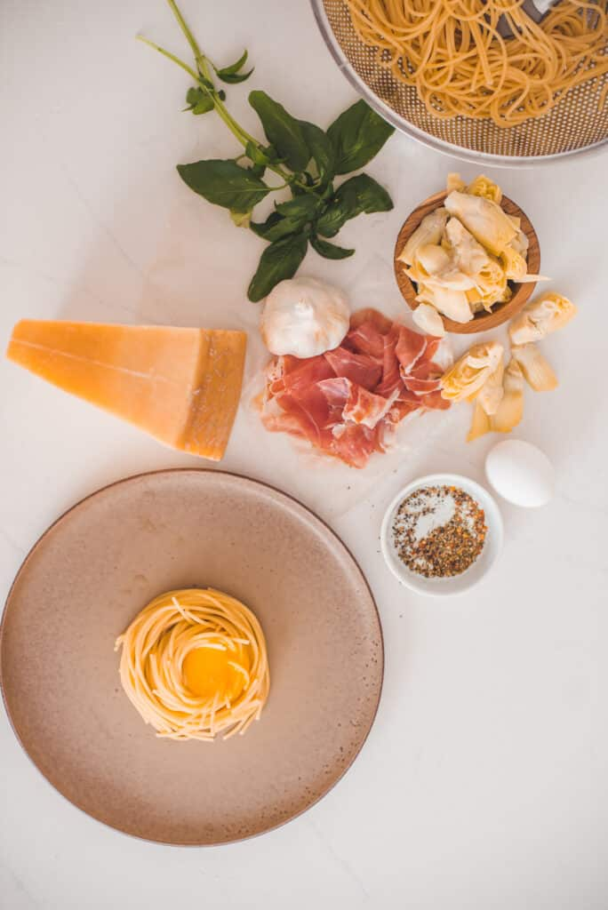 Pasta. Ham, Egg Yolks, Cheese and other Ingredients to make Classic Carbonara