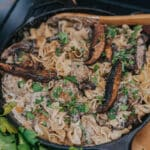 Cast iron pan filled with creamy meatball stroganoff and portabella mushrooms
