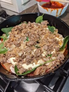 Showing the ground sausage layer for skillet lasagna recipe