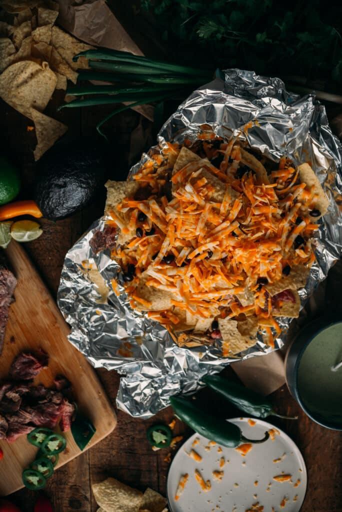 Campfire Nachos with Carne Asada served in Foil Paper