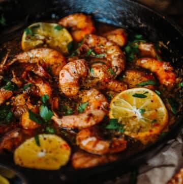 shell on jumbo shrimp in skillet for Cast Iron New Orleans BBQ Shrimp