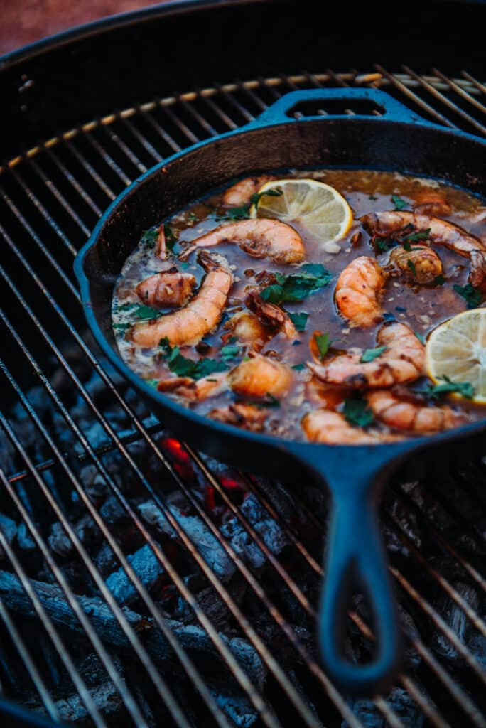 Cooking Jumbo Gulf Shrimp on Cast Iron Skillet over charcoal griller