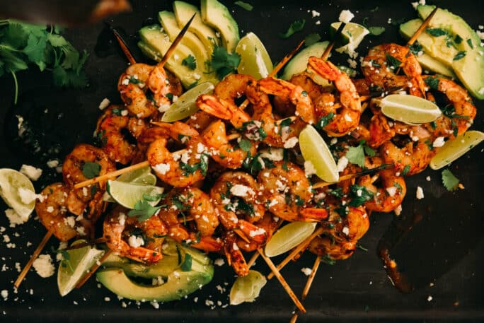 Barbecue shrimp Skewers garnished with lime and cilantro