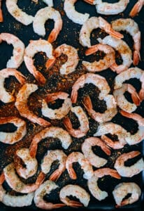 raw shrimp with seasoning sprinkled on top