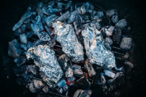 foil wrapped baked potatoes directly on coals