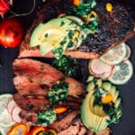 sliced tri tip with avocado, chimichurri and peppers