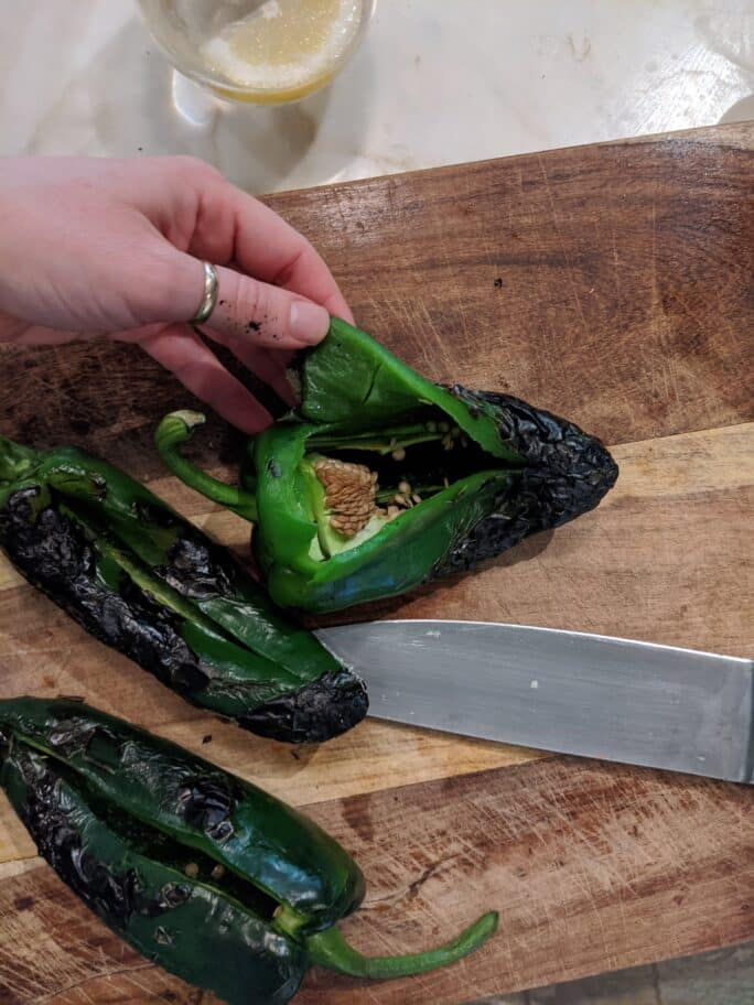 showing roasted poblano open to remove seeds