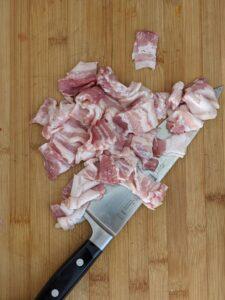 Chopped bacon on board