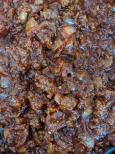 close up of ground beef simmering for sloppy joes