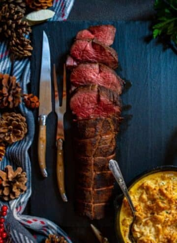 Smoked beef tenderloin with a side of smoked crab imperial and a few carving knives.