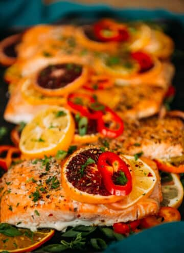 baked salmon topped with citrus and herbs