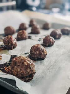 close up of lamb meatballs fresh from the oven after being baked