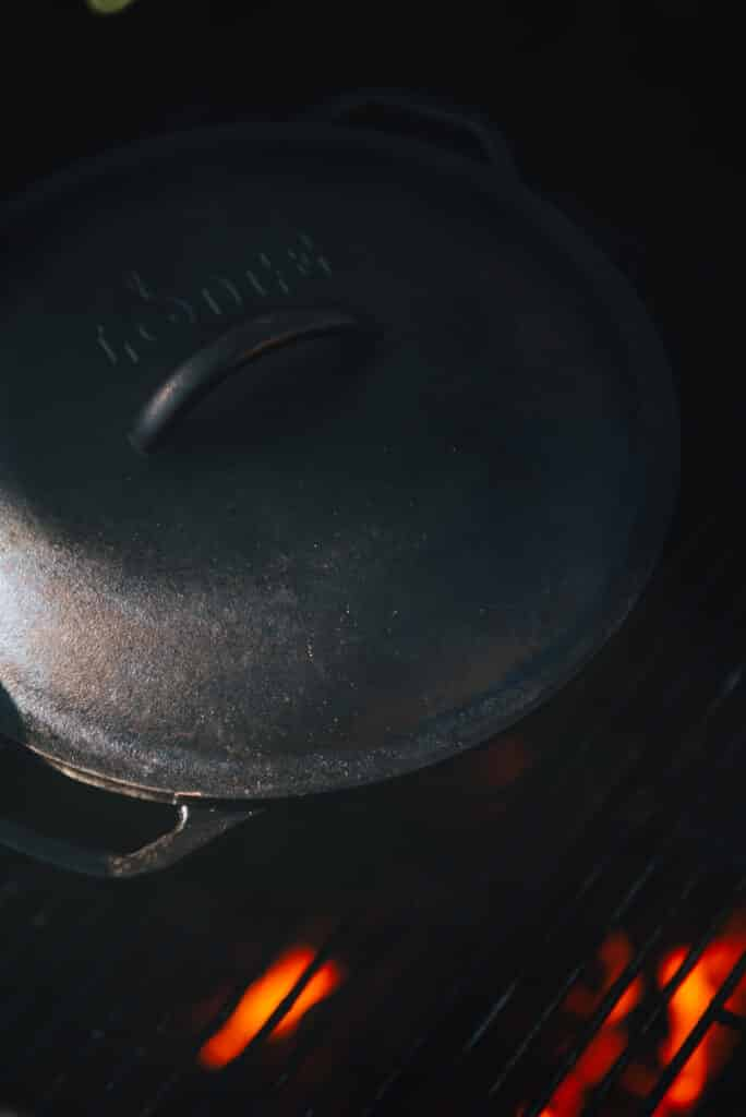 dutch oven with lid on over indirect fire