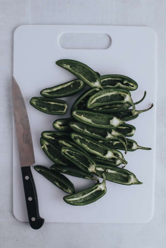 cut open jalapenos and remove seeds and stems