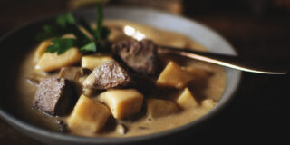 Big bites of beef in a creamy bowl of potato soup